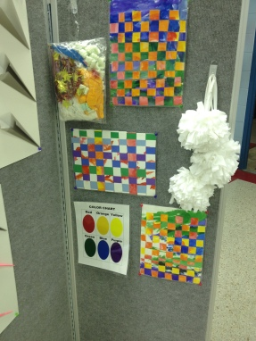 Display board complete with sensory items, a color chart and some woven art pieces!